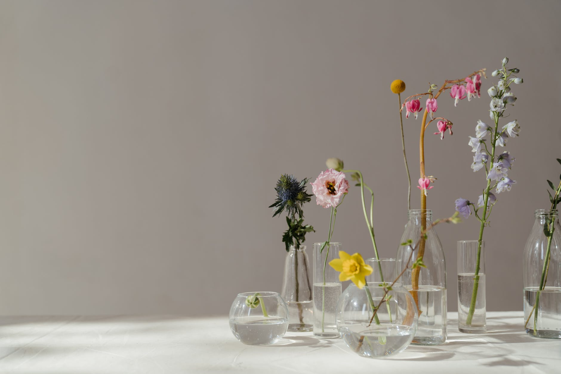 photo of flowers in glass vase with water